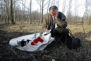 Man mourning at the crash site in Smolensk. Source: The Guardian
