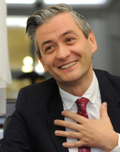 In this  Friday, Nov. 28, 2014 photo,  lawmaker Robert Biedron, Poland's first openly gay lawmaker, speaks to The Associated Press at the parliament building in Warsaw, Poland. Biedron, 38, was elected Sunday Nov. 30, 2014  to be the mayor of the northern Polish city of Slupsk, making him also the first openly gay mayor in Poland. His political success comes amid growing social acceptance for gays and lesbians in Poland, a conservative and mostly Roman Catholic country. (AP Photo/Alik Keplicz)