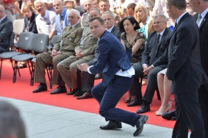 President Duda saves a communion wafer.
